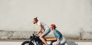 Teenagers riding a Motorcycle